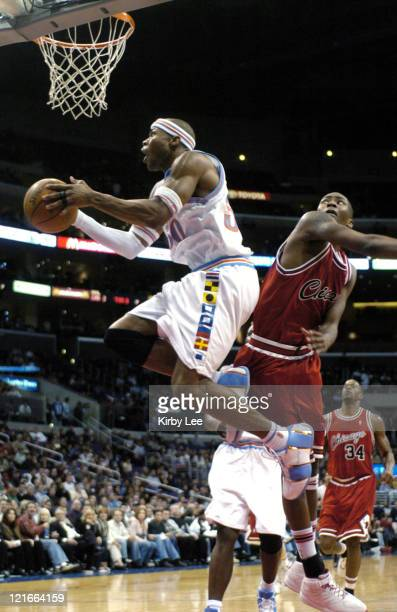 Quentin Richardson of the Los Angeles Clippers drives past Jamal Crawford of the Chicago Bulls during the game between the Los Angeles Clippers and...