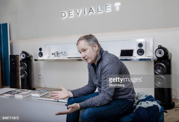 Quentin Sanni cofounder of Devialet SAS gestures while speaking at the Analogue Digital Hybrid amplification technology company's showroom in Paris...