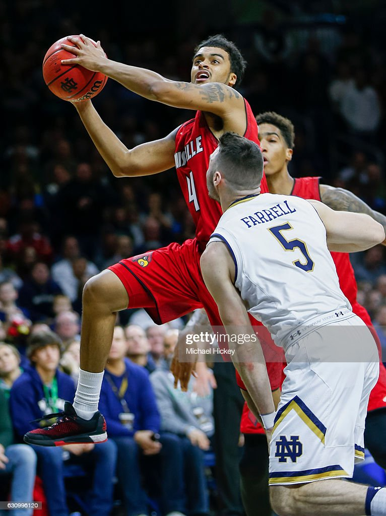 Quentin Snider #4 of the Louisville Cardinals goes up to shoot during the game as Matt Farrell #5 of the Notre Dame Fighting Irish defends at Purcell Pavilion on January 4, 2017 in South Bend, Indiana.