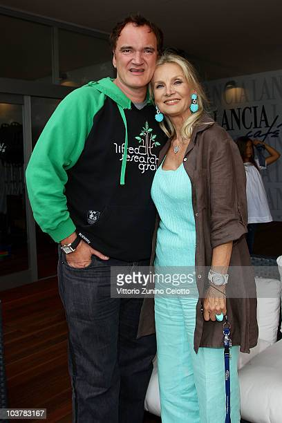 Quentin Tarantino and Barbara Bouchet attend the Lancia Cafe during the 67th Venice International Film Festival on September 2 2010 in Venice Italy