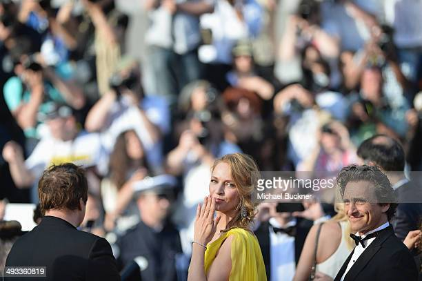 Quentin Tarantino Uma Thurman and Lawrence Bender attend the 'Clouds Of Sils Maria' premiere during the 67th Annual Cannes Film Festival on May 23...