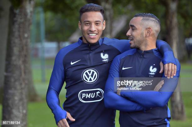 Quentin Tolisso and Dimitri Payet of France react during a France training session on October 3 2017 in Clairefontaine France