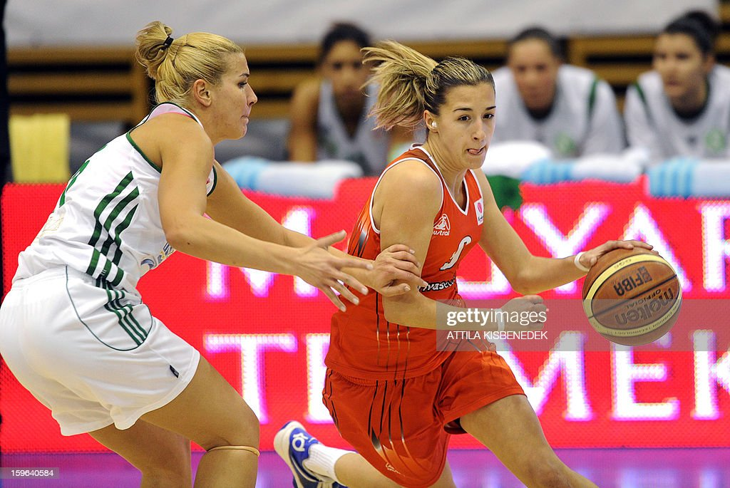Queralt Casas (R) of Spanish Rivas Ecopolis vies for the ball with captain Nora Nagy-Bujdoso of Hungarian Hat-Agro UNI Gyoer during the Women Euroleague basketball match Hungarian Hat-Agro UNI Gyoer vs Spanish Rivas Ecopolis on January 17, 2013 in Gyoer, Hungary.
