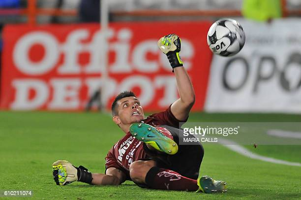 Queretaro goalkeeper Tiago Volpi tries to stop the ball during their match against Pachuca during their Mexican Clausura 2016 Tournament football...