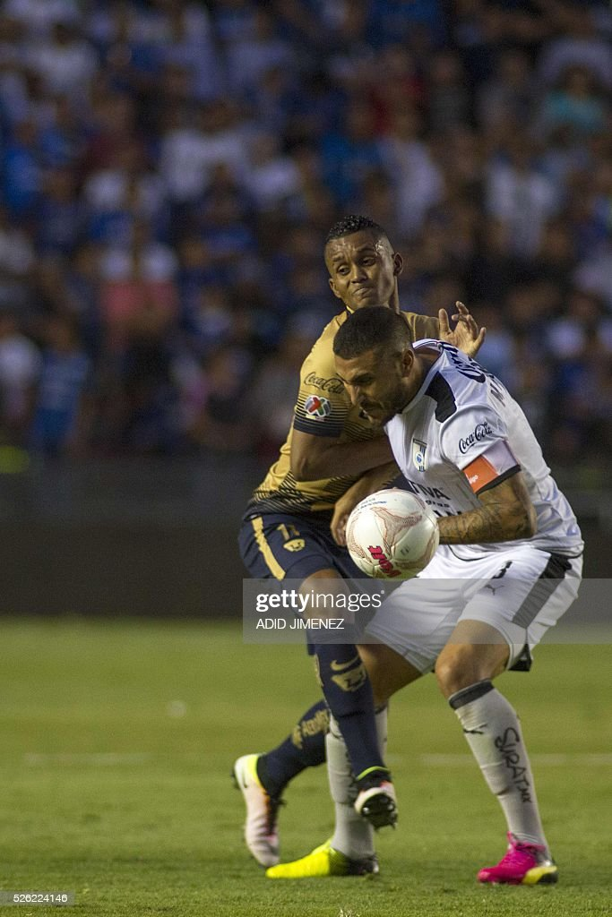 Queretaro's defender Miguel Martinez (R) vies for the ball with Pumas's midfielder Fidel Martinez during their Mexican Clausura tournament football match at La Corregidora stadium on April 29, 2016, in Queretaro, Mexico.