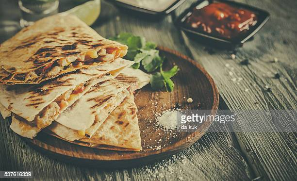 Quesadilla on aged wooden table