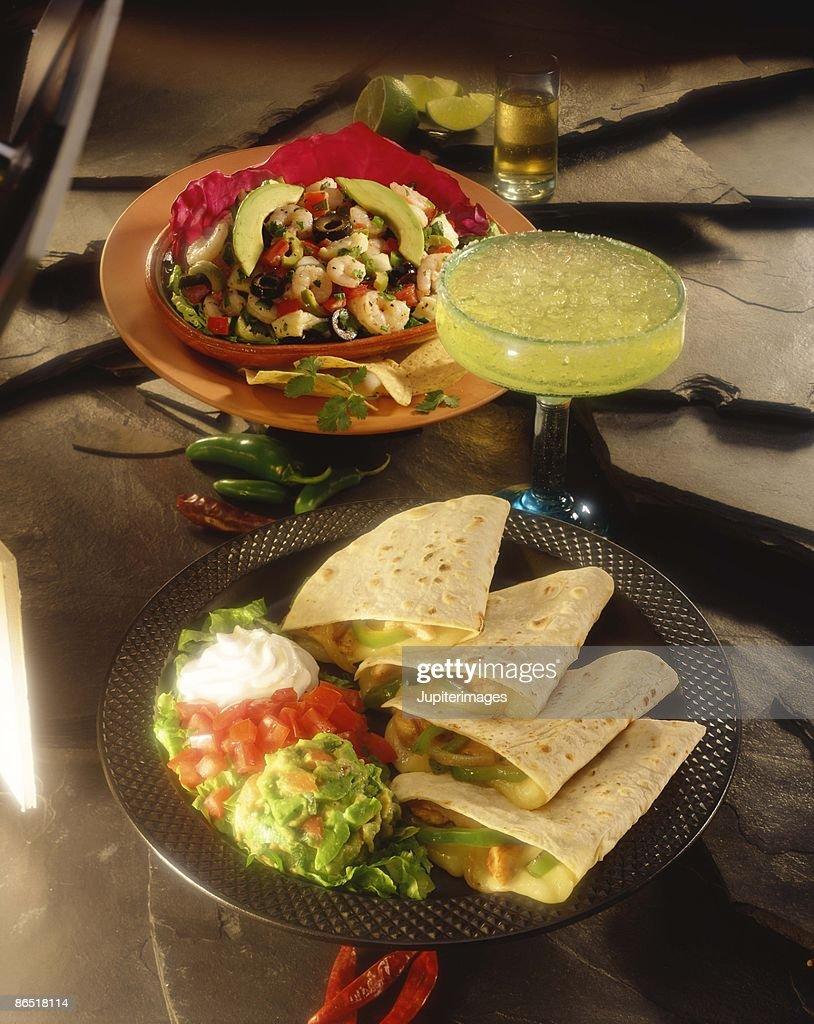 Quesadillas and shrimp with avocado salad : Stock Photo