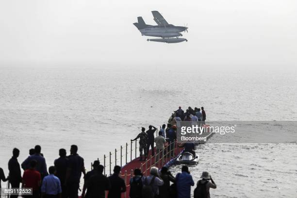 A Quest Aircraft Co amphibiousKodiakplane operated by SpiceJet Ltd prepares to land on water during a demonstration flight event in Mumbai India on...