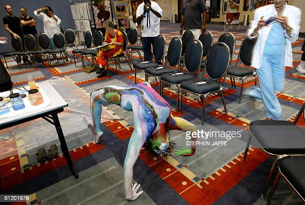Quest Skinner shows off her body during an exhibition of body painting at the First International Nude Art Expo 21 August at the Washington...
