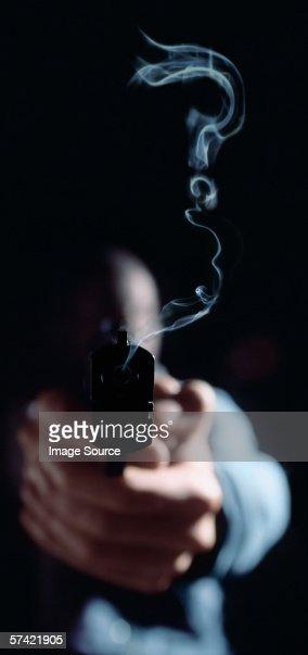 Question mark in gun smoke