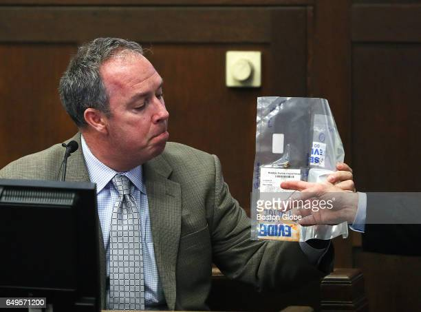 Questioned by ADA Patrick Haggan retired Boston police officer Michael Griffin testifies about evidence he collected at the crime scene The double...
