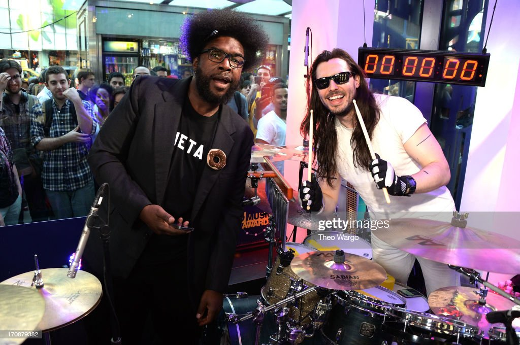 <a gi-track='captionPersonalityLinkClicked' href=/galleries/search?phrase=Questlove&family=editorial&specificpeople=537550 ng-click='$event.stopPropagation()'>Questlove</a> and <a gi-track='captionPersonalityLinkClicked' href=/galleries/search?phrase=Andrew+W.K.&family=editorial&specificpeople=609488 ng-click='$event.stopPropagation()'>Andrew W.K.</a> perform during the MTV, VH1, CMT & LOGO 2013 O Music Awards on June 19, 2013 in New York City.