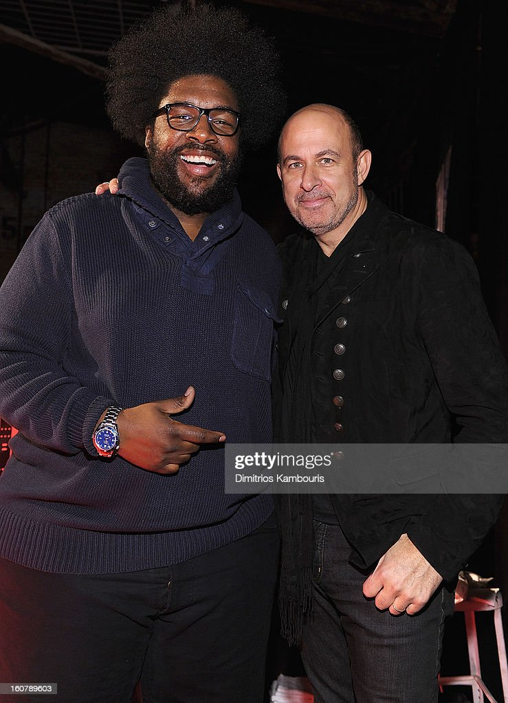 <a gi-track='captionPersonalityLinkClicked' href=/galleries/search?phrase=Questlove&family=editorial&specificpeople=537550 ng-click='$event.stopPropagation()'>Questlove</a> and designer John Varvatos pose for a picture as they Celebrate The New JohnVarvatos.com on February 5, 2013 in New York City.