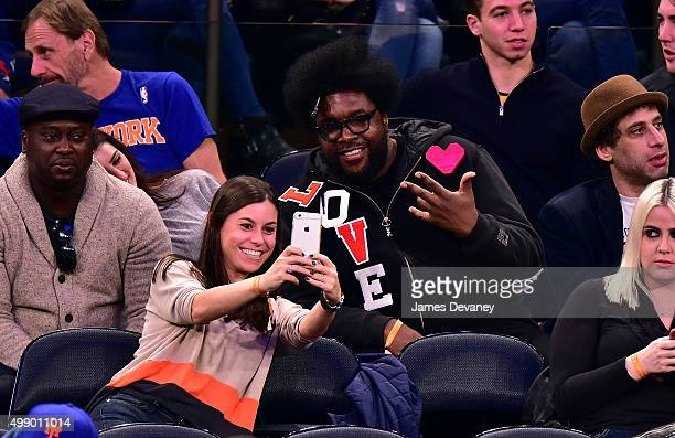 Questlove and fan attend New York Knicks vs Miami Heat game at Madison Square Garden on November 27 2015 in New York City