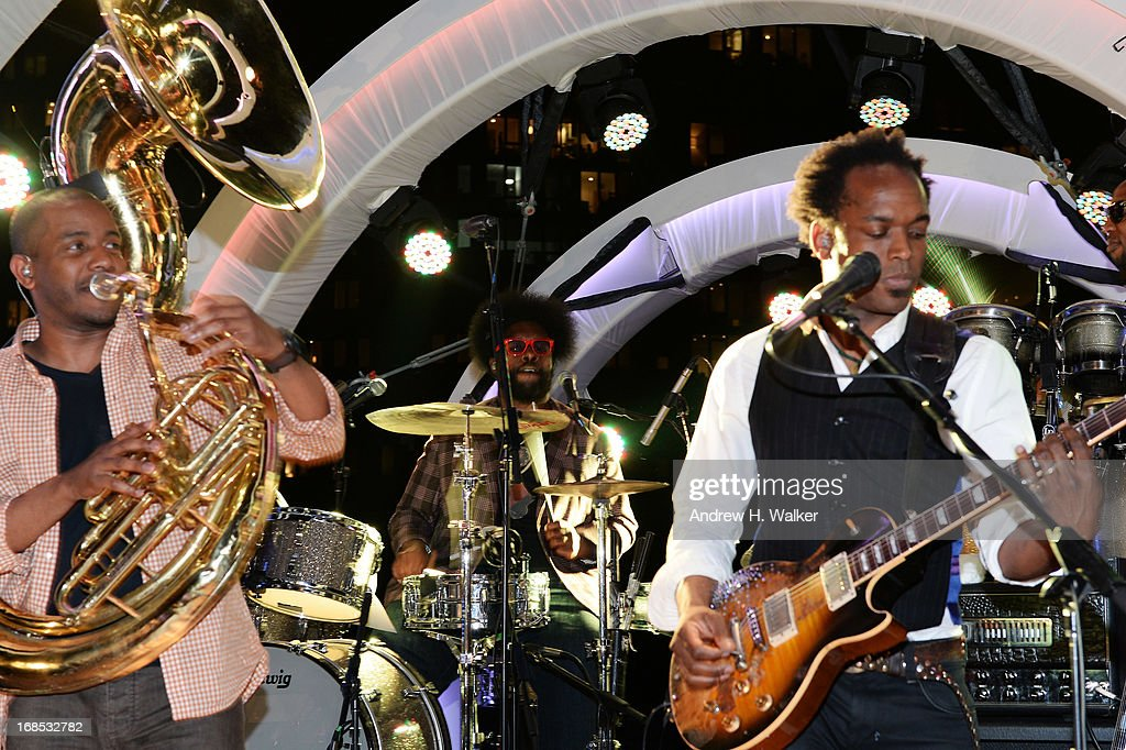 <a gi-track='captionPersonalityLinkClicked' href=/galleries/search?phrase=Questlove&family=editorial&specificpeople=537550 ng-click='$event.stopPropagation()'>Questlove</a> (C) and The Roots perform at the grand opening of the Audi and Volkswagen Manhattan dealership on May 10, 2013 in New York City.