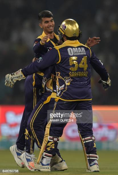 Quetta Gladiators spinner Hassan Khan celebrates with team captain and wicketkeeper Sarfraz Ahmed after taking the wicket of Khusdil Shah of Peshawar...