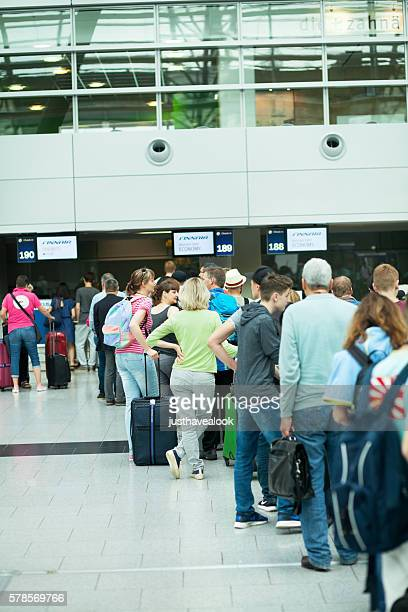 Queue of passengers at check-in