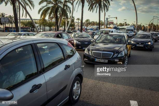 A queue of traffic sits at the entrance to Cinturon del Litoral de Barcelona highway after protesters blockaded city roads during a regional strike...