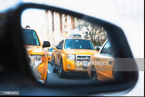 Queue of yellow cabs viewed through wing mirror, New York City, USA : Stock Photo