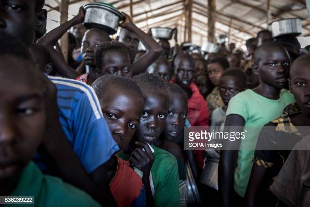 Queue to receive a portion of food Every day in the settlement of Bidi Bidi over 10 000 refugees need to be fed everyday The number of South Sudanese...