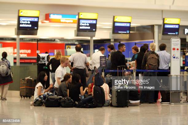Queues form in Terminal 5 of Heathrow Airport London after a glitch in the air traffic control system caused scores of flights to be cancelled or...