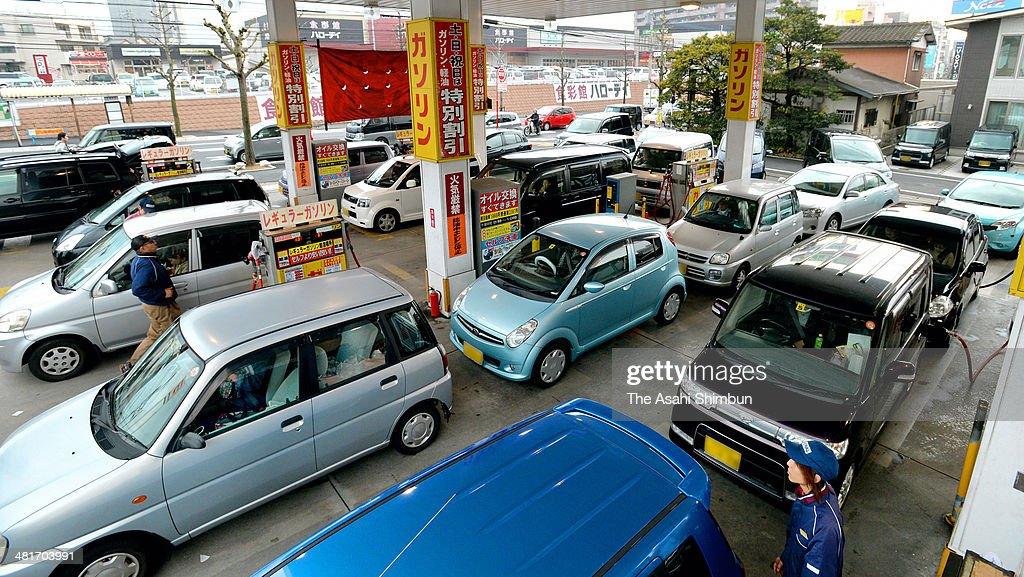 Queues to fill petrol before the eight percent consumption tax is applied on April 1 are seen at a petrol station on the fianl weekend before the tax hike on March 30, 2014 in Kitakyushu, Fukuoka, Japan. Japan raises consumption tax from 5 to 8 percent on April 1, and possibly to 10 percent in October 2015, despite market concerns about a slowing of the economic recovery.