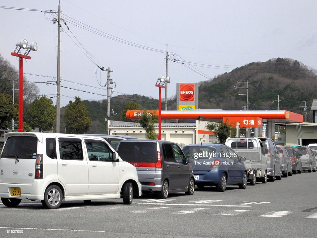 Queues to fill petrol before the eight percent consumption tax is applied on April 1 are seen at a petrol station on March 31, 2014 in Sasayama, Hyogo, Japan. Japan raises consumption tax from 5 to 8 percent on April 1, and possibly to 10 percent in October 2015, despite market concerns about a slowing of the economic recovery.
