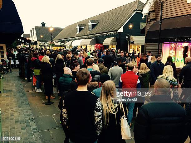 Queuing to get into Ralph Lauren Black Friday at Bicester Village designer outlet shopping centre Oxfordshire UK Friday 28 November 2014