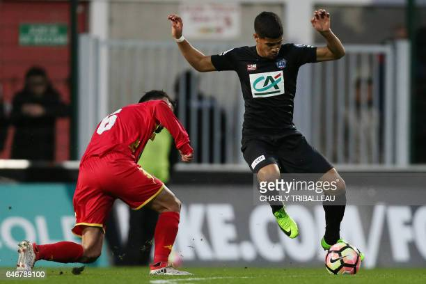 Quevilly Rouen's French Portuguese midflier Stanislas Oliveira vies with Guingamp's French midfielder Ludovic Blas during the French Cup football...