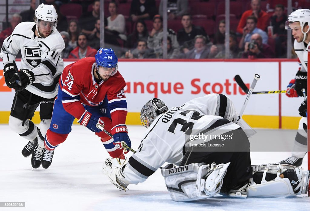 Quick #32 of the Los Angeles Kings blocks the shot from Phillip Danault #24 of the Montreal Canadiens Jonathan in the NHL game at the Bell Centre on October 26, 2017 in Montreal, Quebec, Canada.