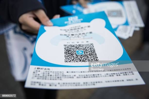A quick response code is displayed on an advertisement for Ant Financial Services Group's Alipay an affiliate of Alibaba Group Holding Ltd at a...