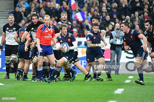 A quick tap penalty and clever pass by Baptiste Serin of France leads to a try for Louis Picamoles of France during the test match between France and...