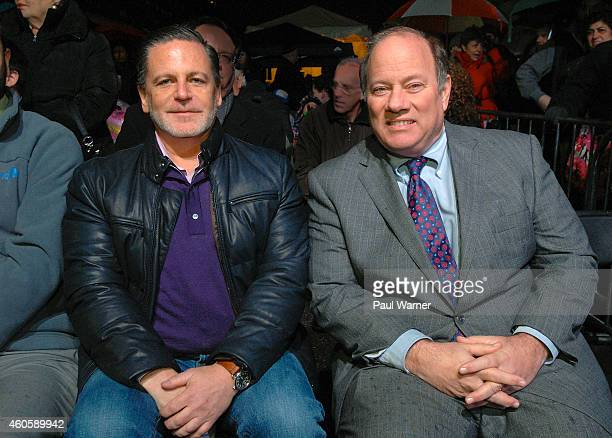 Quicken Loans owner Dan Gilbert and City of Detroit mayor Mike Duggan attend the Menora in the D Lighting at Campus Martius Park on December 16 2014...
