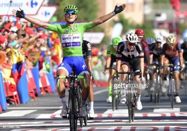 QuickStep Floors' Italian cyclist Matteo Trentin celebrates as he crosses the finish line winning the 13th stage of the 72nd edition of 'La Vuelta'...
