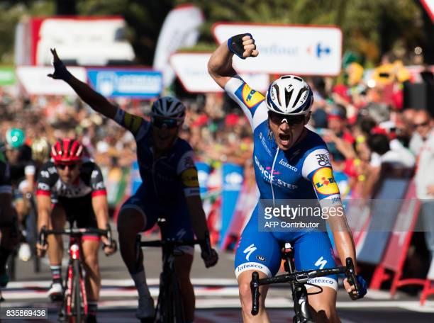 TOPSHOT QuickStep Floors team's Begium cyclist Yves Lampaert celebrates as he crosses the finish line to win the 2nd stage of the 72nd edition of 'La...