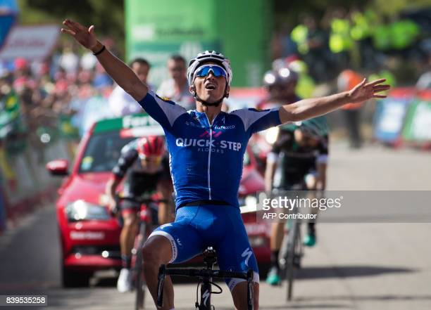 QuickStep Floors Team's French cyclist Julian Alaphilippe celebrates as he crosses the finish line to win the 8th stage of the 72nd edition of 'La...