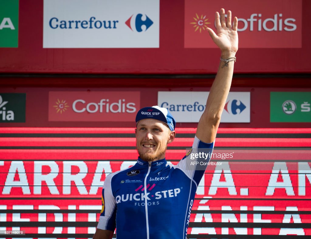 Quick-Step Floors Team's Italian cyclist Matteo Trentin celebrates on the podium after winning the 4th stage of the 72nd edition of 'La Vuelta' Tour of Spain cycling race, a 198,2km route between Escaldes-Engordany to Tarragona on August 22, 2017. /