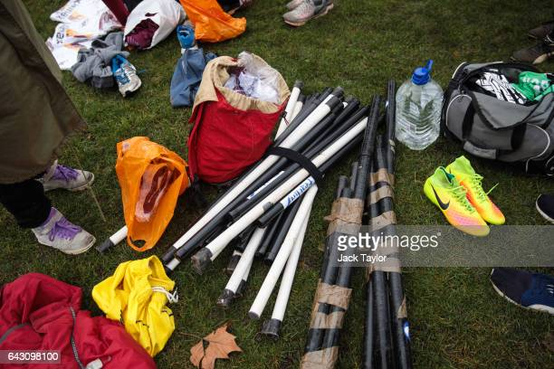 Quidditch brooms are pictured during the Crumpet Cup quidditch tournament on Clapham Common on February 18 2017 in London England Quidditch is the...
