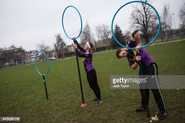 Quidditch players Eva Verpe and Matt Bateman set up the hoops before the Crumpet Cup quidditch tournament on Clapham Common on February 18 2017 in...