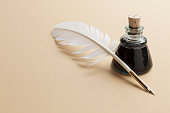 Quill pen and ink bottle background with copy space.