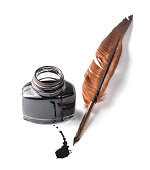 Quill pen and ink well on white background.