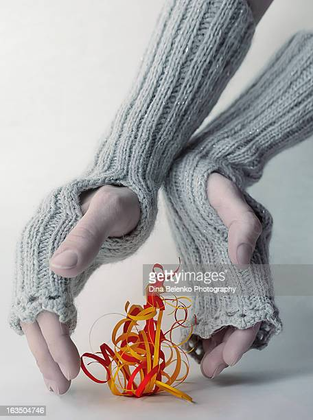 Quilling paper fire and hands in mittens