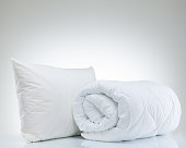 Quilt and pillow on the white background