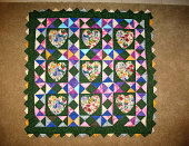 Quilt incorporating applique and prairie points