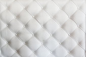 quilted leather sofa covering closeup background