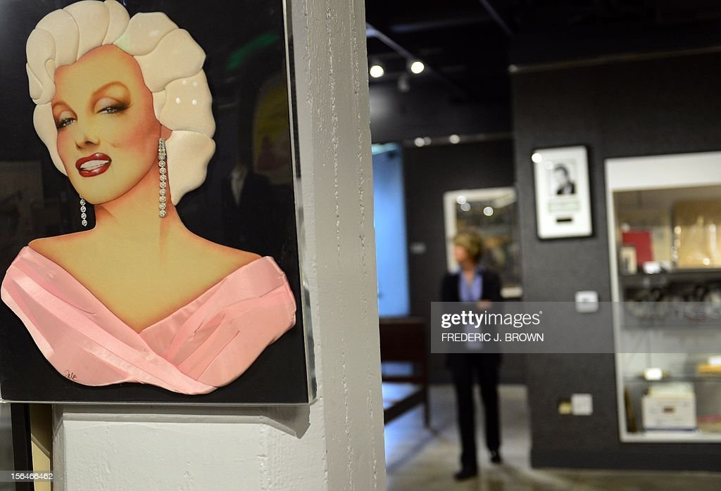 A quilted portrait image of Marilyn Monroe with airbrushed facial features, part of a group of Marilyn Monroe memorabilia estimated between $300 and $400, is displayed during a press preview at auction house Bonham's in Hollywood, California, on November 15, 2012, where Charlie Chaplin's iconic bowler hat and cane are to go under the hammer in this weekend as part of an auction which also includes the John Lennon nude drawing of himself and Yoko Ono, part of the Lennon lot estomated between $18,000 and $22,000 , among memorabilia from other artists. The hat and cane trademark of Chaplin's Little Tramp character are in 'remarkable condition' and are estimated to go for between $40,000 and $60,000 at the sale by auction house Bonhams on Sunday November 18. AFP PHOTO / Frederic J. BROWN