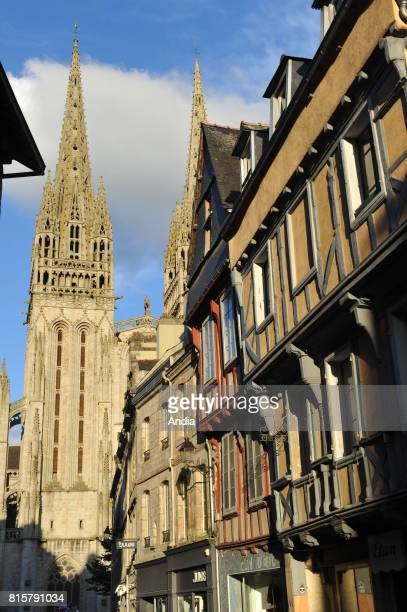 Quimper Facade and spires of Quimper Cathedral built between the XIIIrd and the XIXth century and half timbered houses