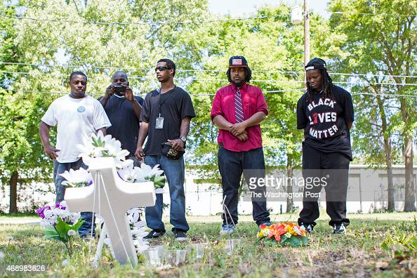 Quin Dalton Justin Lewis Aaron Moses Darrell Mikell take a minute to show their respects at the site where Walter Scott was shot They are all from...