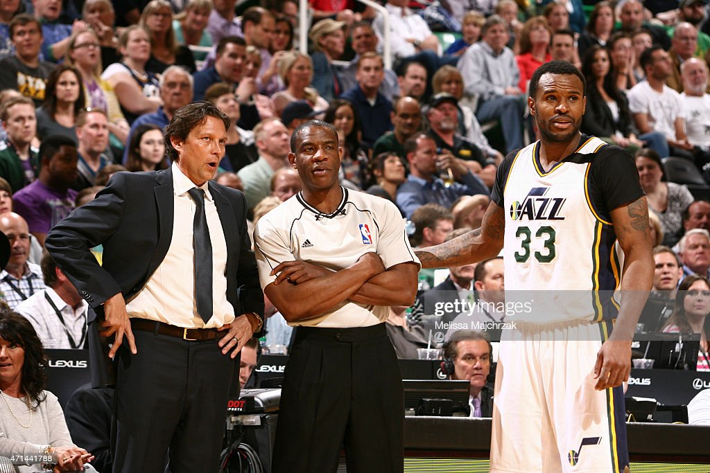 Quin Snyder and Trevor Booker of the Utah Jazz speak to NBA referee Tony Brown during a game against the Dallas Mavericks at EnergySolutions Arena on...