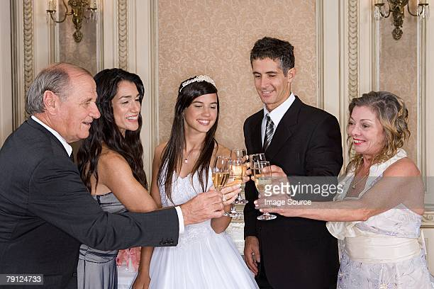 Quinceanera girl toasting with family